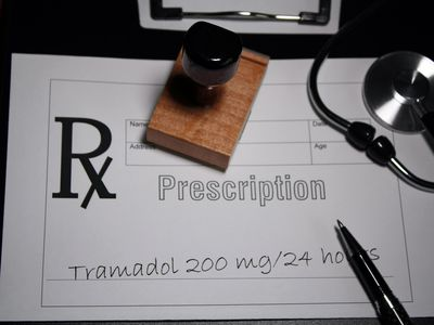 Prescription pad with Rx for tramadol written on it