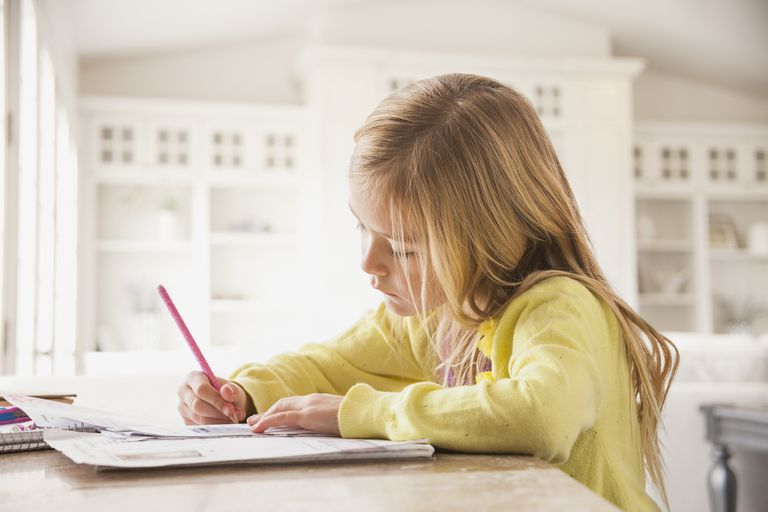 A young girl doing homework