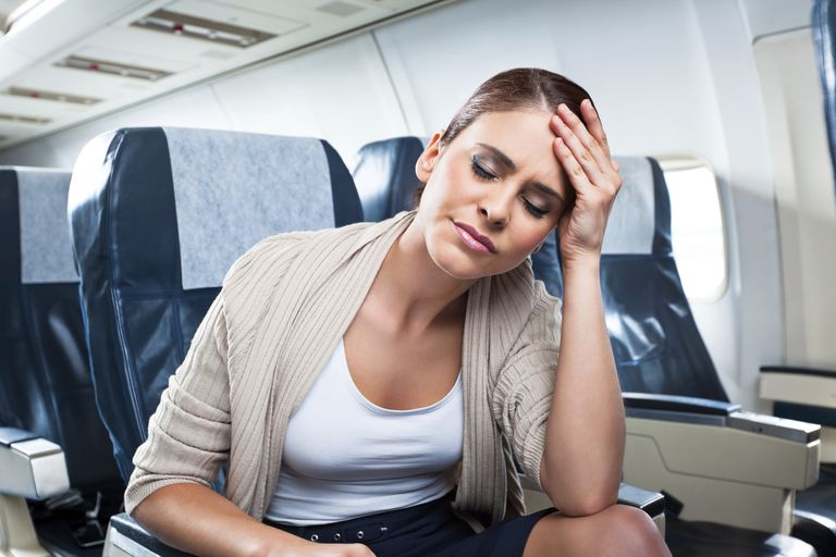 woman in pain on plane