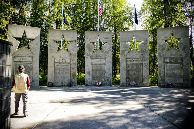 Veteran observing and honoring at the Alaska Veterans Memorial.