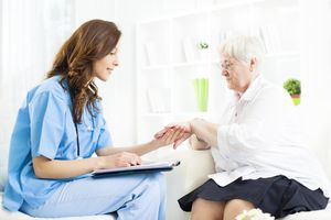 Doctor Checking Psoriasis on Senior Woman patient hand.
