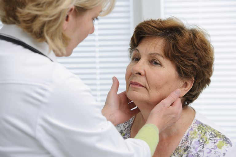 doctor examining a patient's neck