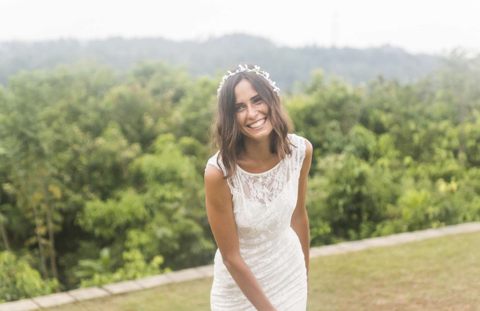 Smiling bride standing outside