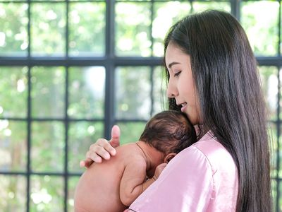 Breastfeeding woman and child