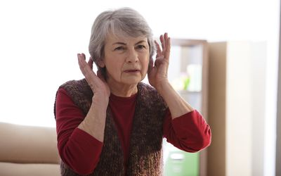 older woman experiencing Noise pollution