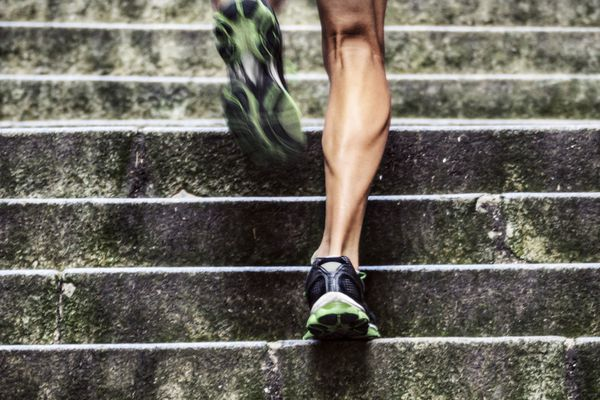 Photo of a man running up the stairs.
