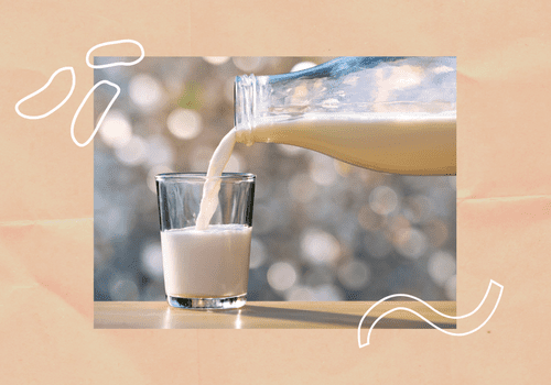 pouring a glass of milk from a jar