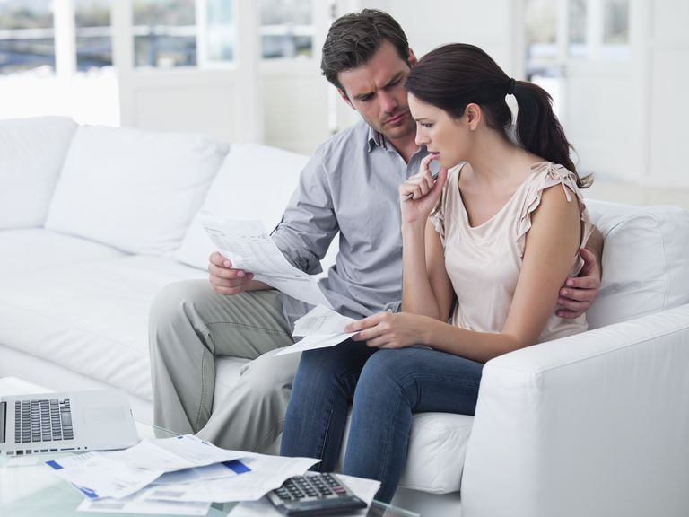 Worried mid adult couple planning home finance