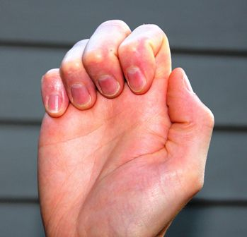 hand demonstrating fingers down position
