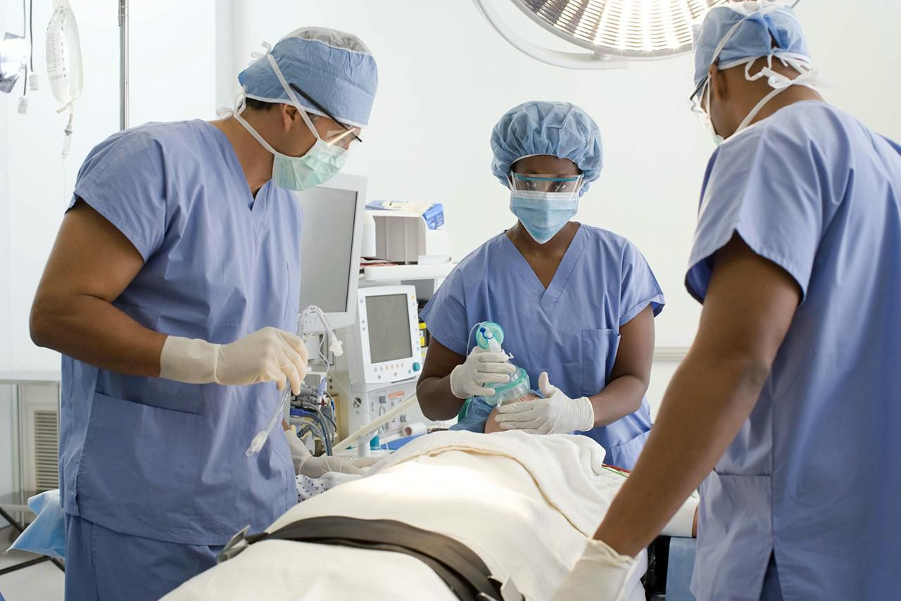 Doctors with a patient in operating room