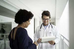 Doctor explaining medical exam to a patient at hospital