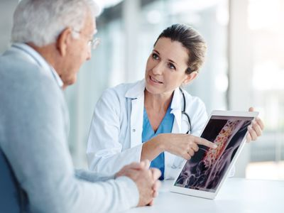 A spine doctor talking to her patient