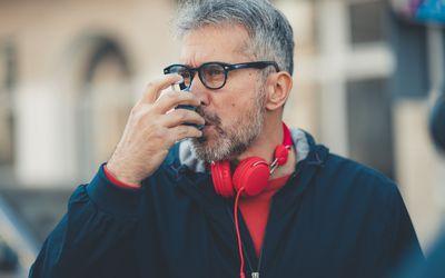 Man using an asthma inhaler