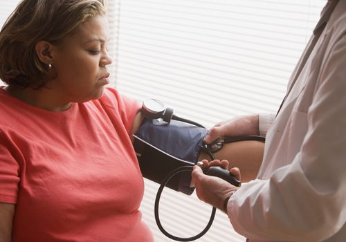 A woman having her blood pressure taken