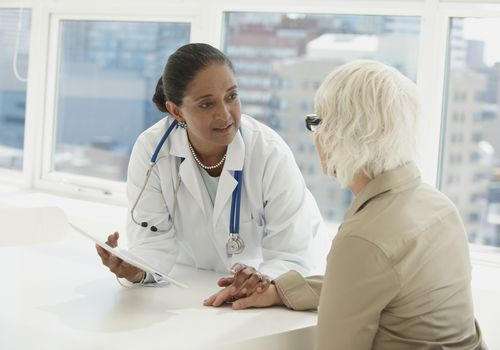Doctor talking with patient about her Mini-Cog test results