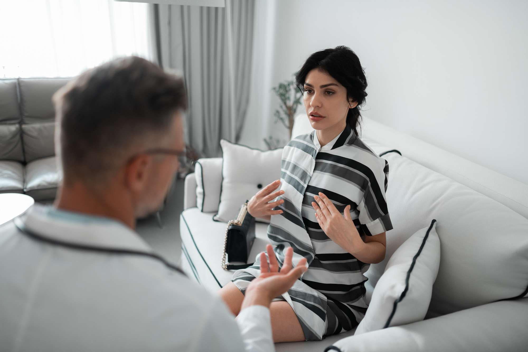 Woman explaining breast worries to doctor