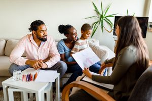 Family with one child on a session with a counselor.