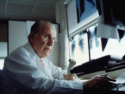 radiologist reading a radiation port film prior to therapy