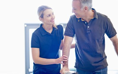 patient and occupational therapist smiling at each other