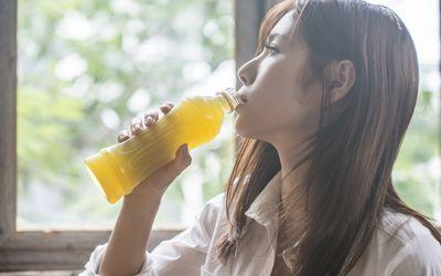 Woman drinking tea from bottle