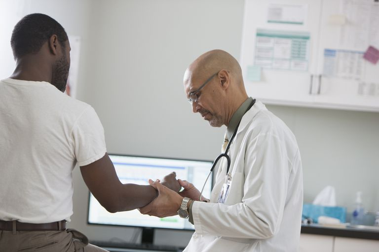 Doctor checking patient at clinic