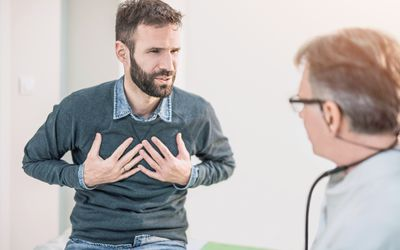 A man talking to his doctor about his asthma.