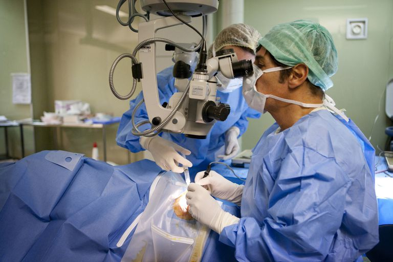 Surgeon during operation for glaucoma treatment
