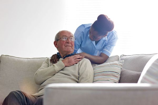 Nurse consoling older man