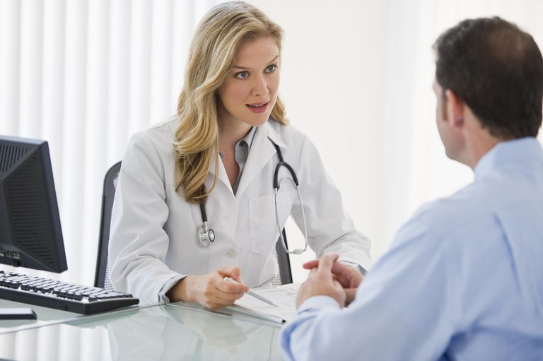 young female doctor talking to a male patient