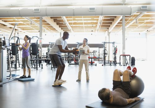 Physical therapist in gym with patient