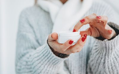 female hand with hand cream
