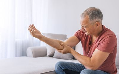 Man holding his painful elbow