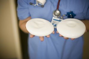 Healthcare worker holding breast implants