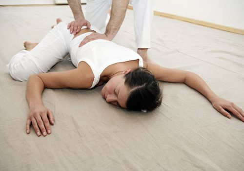 woman having shiatsu performed