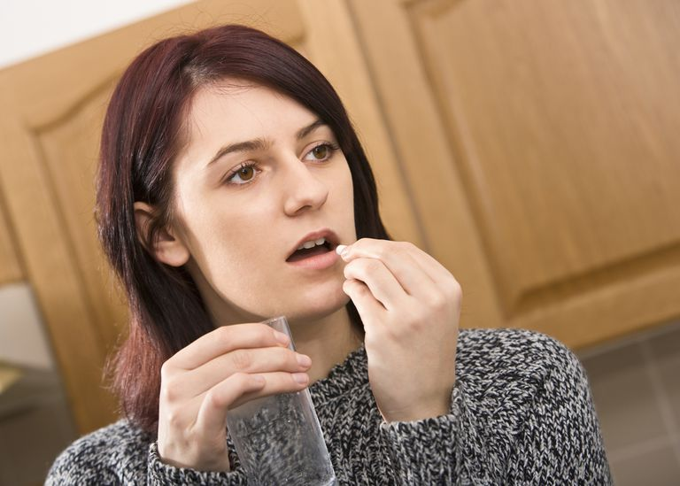 Woman anxious about taking pill