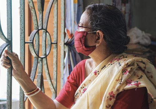 Older woman in India during a COVID lockdown order.