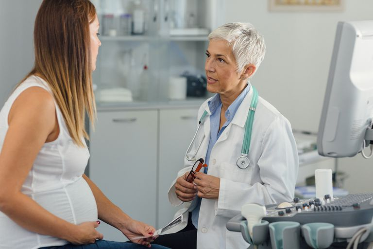 Pregnant Woman And Female Doctor In A Consultation.