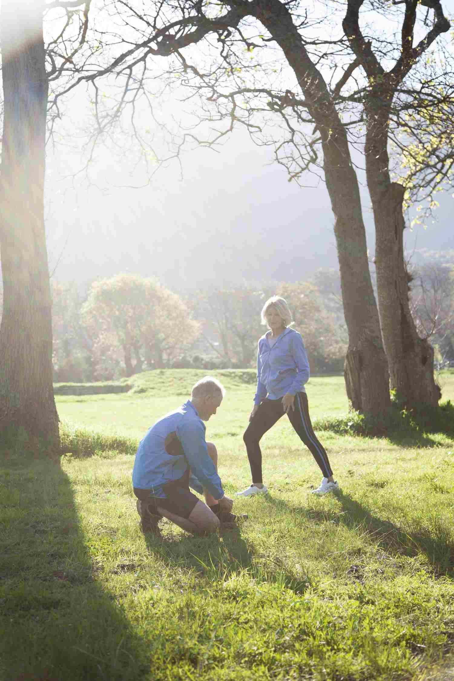 Senior couple preparing to go jogging