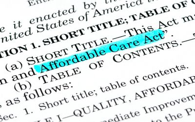 A document with Affordable Care Act highlight with blue highlighter.