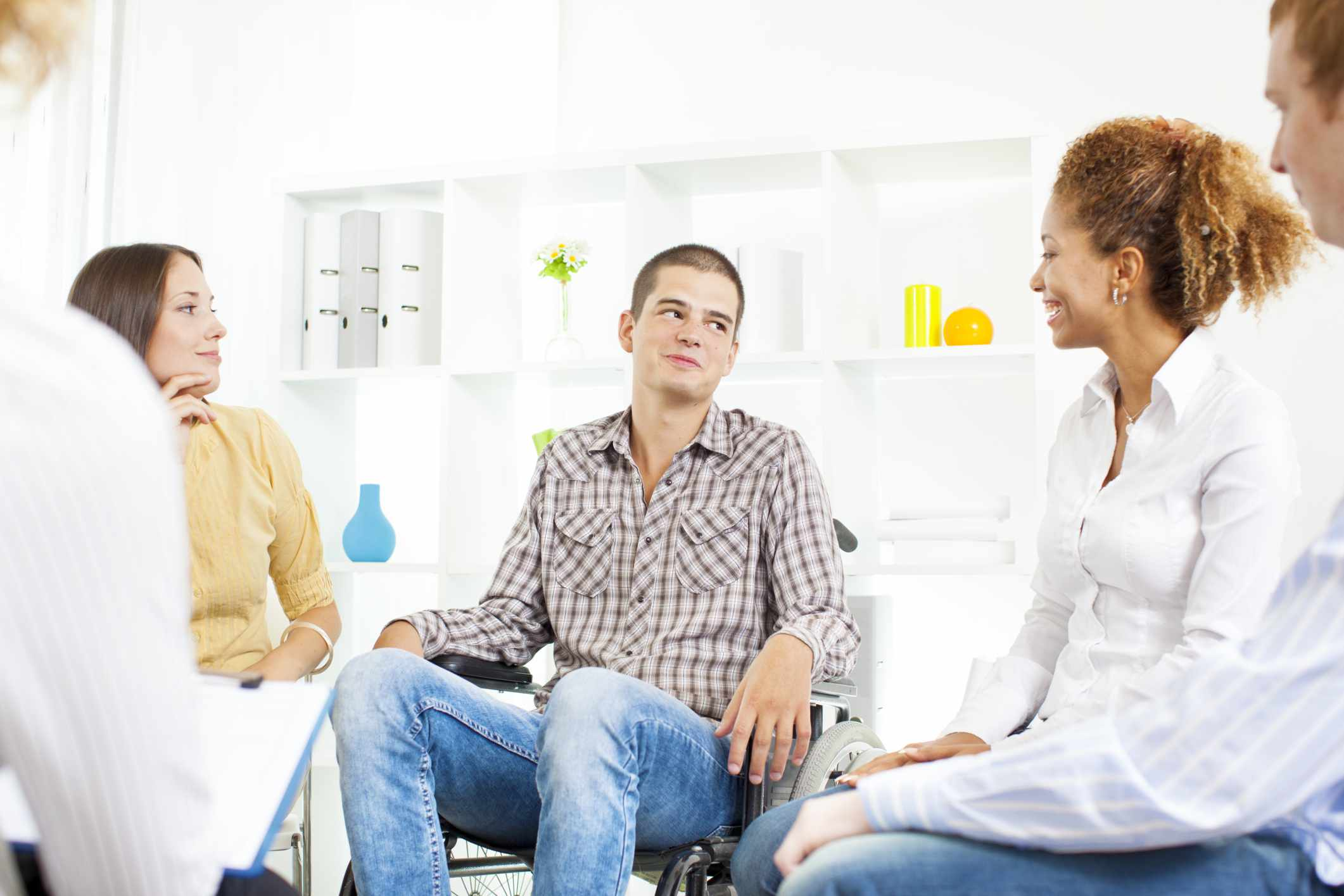 Man in a wheelchair at a support group