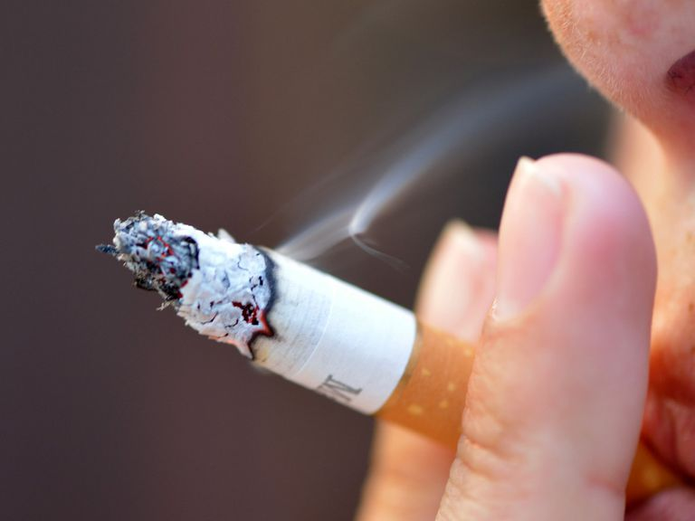 close up of a person smoking