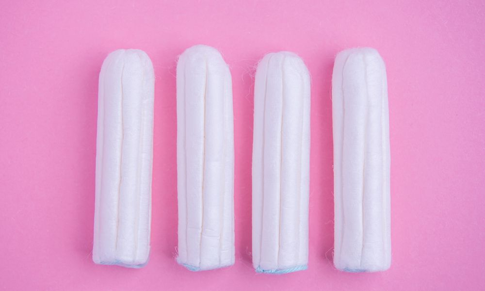 Tampons on pink background.