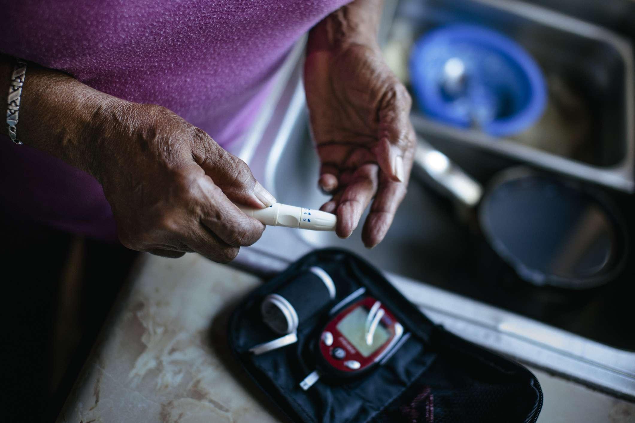 Woman checks blood sugar levels