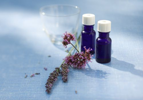 Lavender and tea tree essential oils in blue bottles