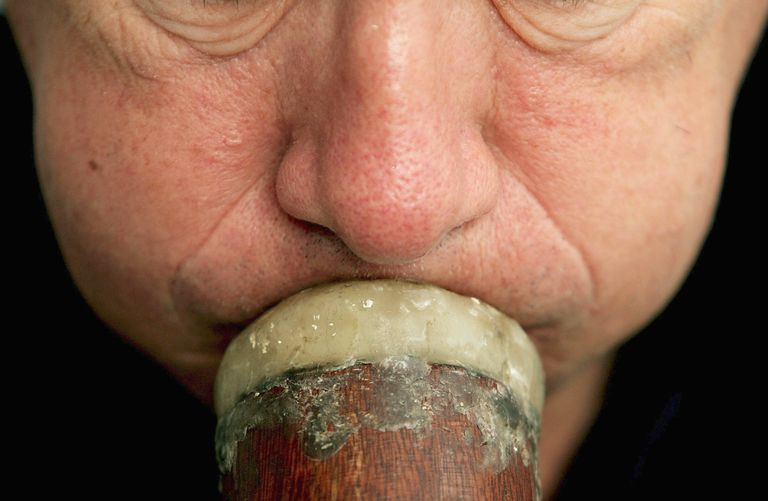 Man blows on the didgeridoo to treat obstructive sleep apnea