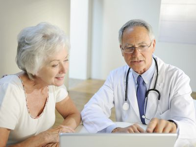 Woman talking to doctor.