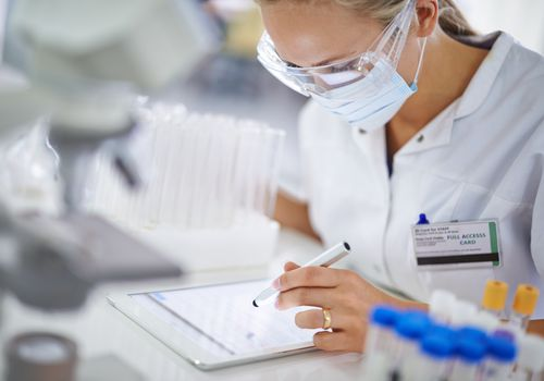 Researcher making notes about a phase 1 clinical trial