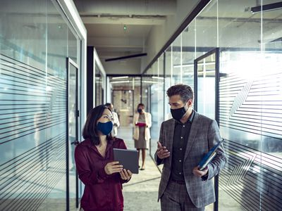 People at an office wearing face masks.