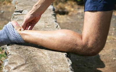 Typical pain in a male jogger`s achilles tendon.