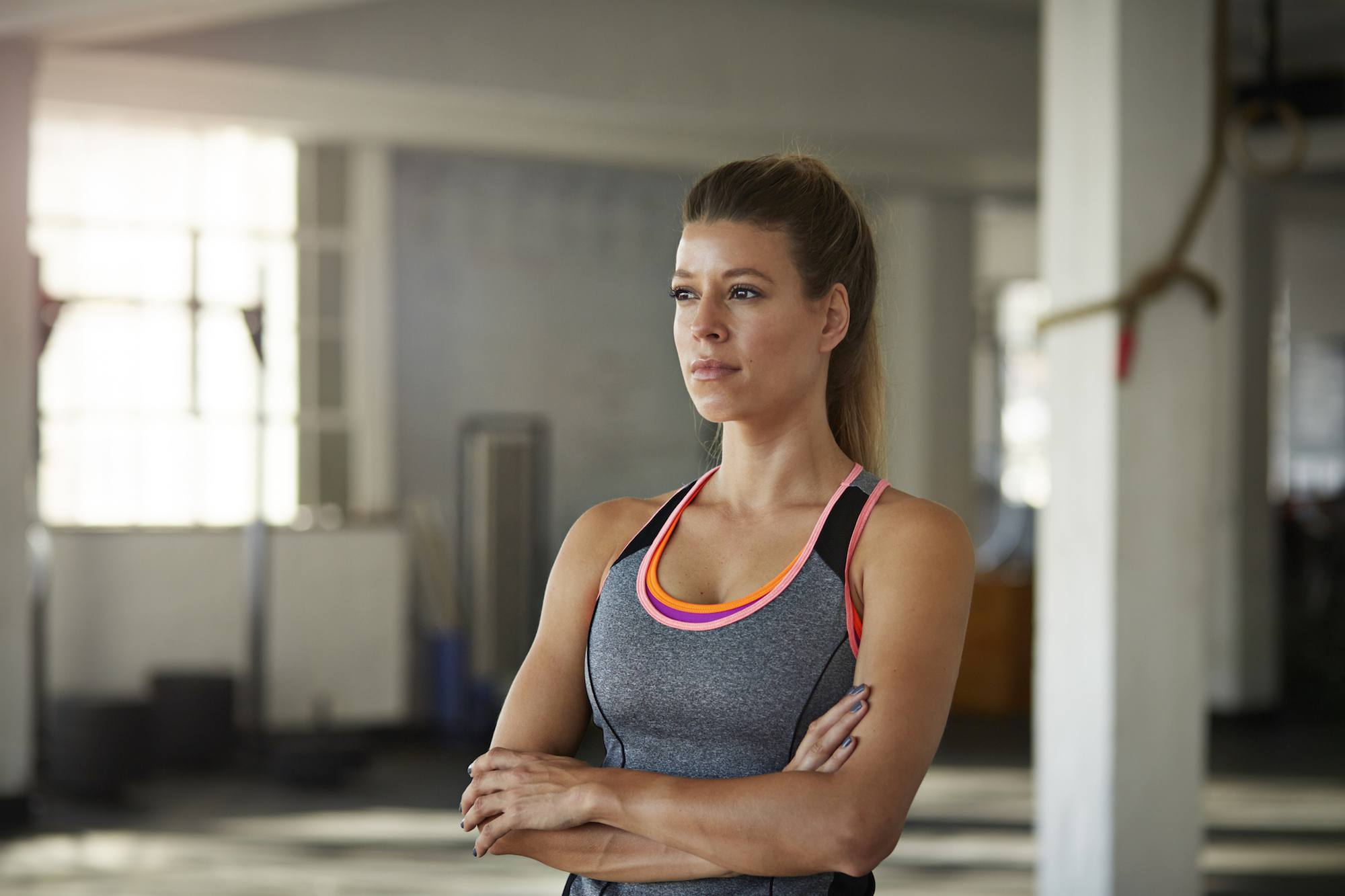 Woman looking straight ahead at gym